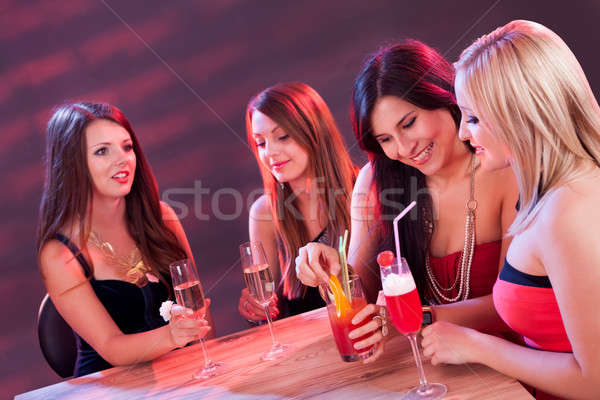 Female friends enjoying a night out Stock photo © AndreyPopov