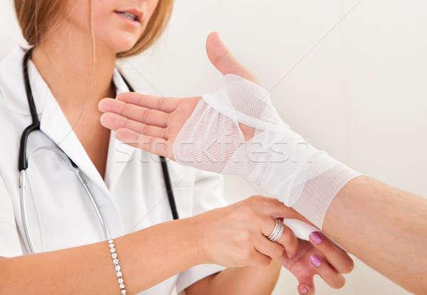 Sprained right hand treated Stock photo © AndreyPopov