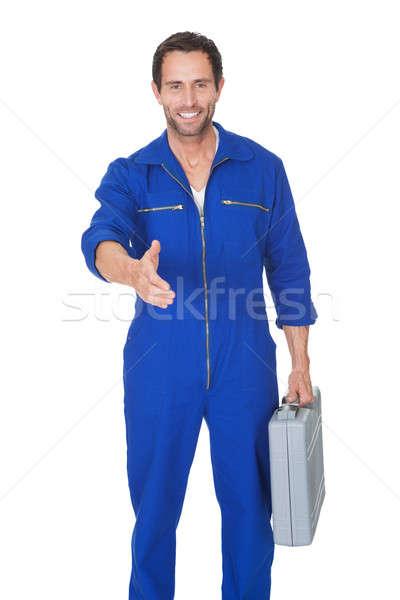 Portrait of happy automechanic offering handshake Stock photo © AndreyPopov