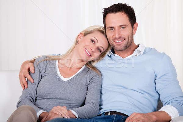 Afetuoso casal relaxante sofá braço em torno de Foto stock © AndreyPopov
