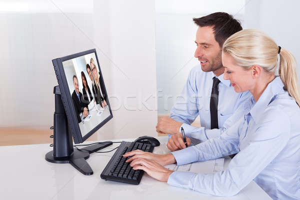 Couple watching an online presentation Stock photo © AndreyPopov
