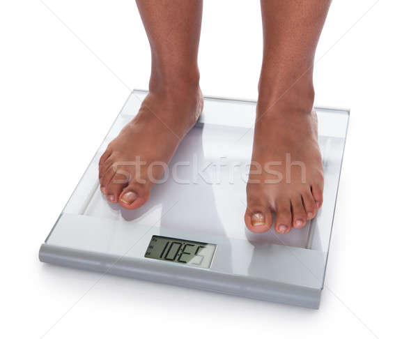 Low Section Of A Young On A Weighing Scale Stock photo © AndreyPopov