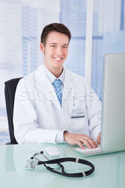 Doctor Using Computer At Desk In Clinic Stock photo © AndreyPopov