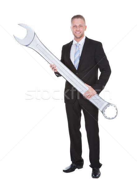 бизнесмен Smart костюм большой металл Сток-фото © AndreyPopov