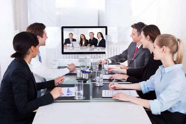 Businesspeople In Video Conference At Business Meeting Stock photo © AndreyPopov
