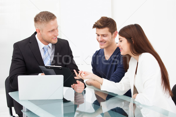 Couple Discussing With Financial Advisor Stock photo © AndreyPopov