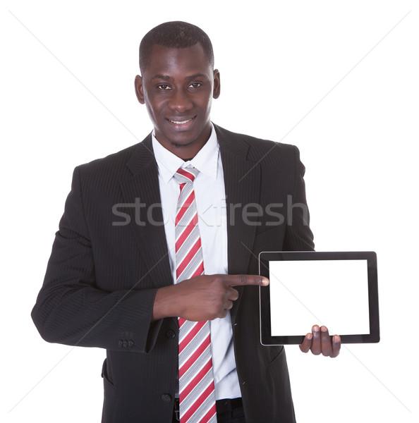 Empresario senalando digital tableta retrato feliz Foto stock © AndreyPopov