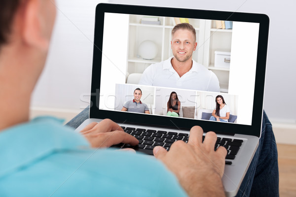 Man Having Video Conference With Friends Stock photo © AndreyPopov