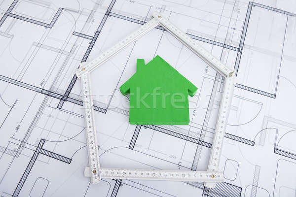 House In Folding Ruler On Blueprint Stock photo © AndreyPopov