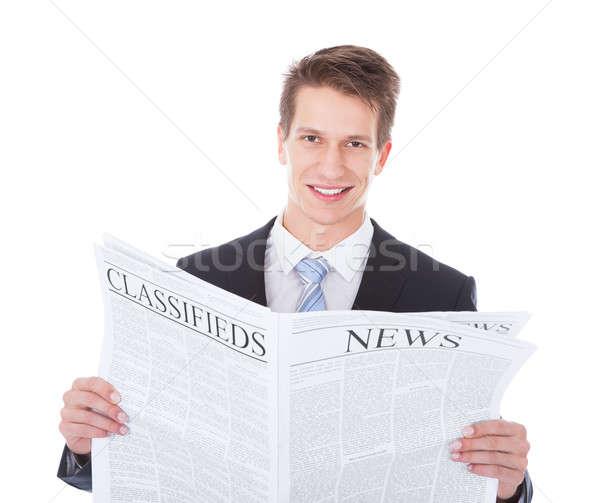 Businessman Holding Newspaper Stock photo © AndreyPopov