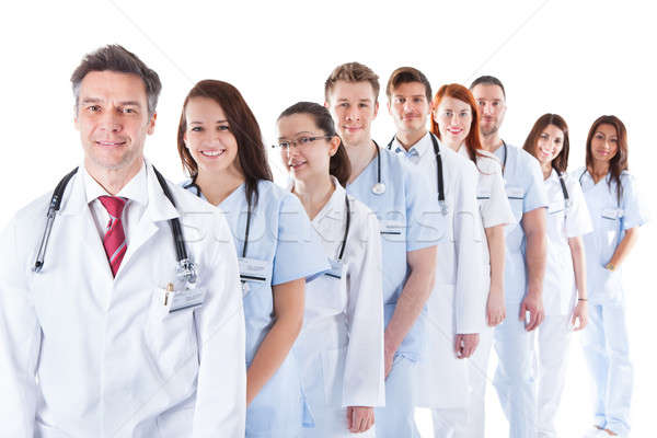 Long line of smiling doctors and nurses Stock photo © AndreyPopov