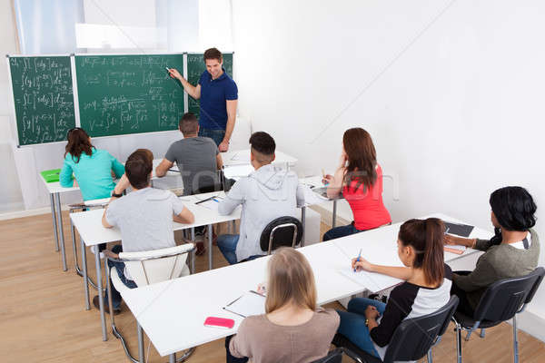 Teacher Teaching Mathematics To College Students Stock photo © AndreyPopov