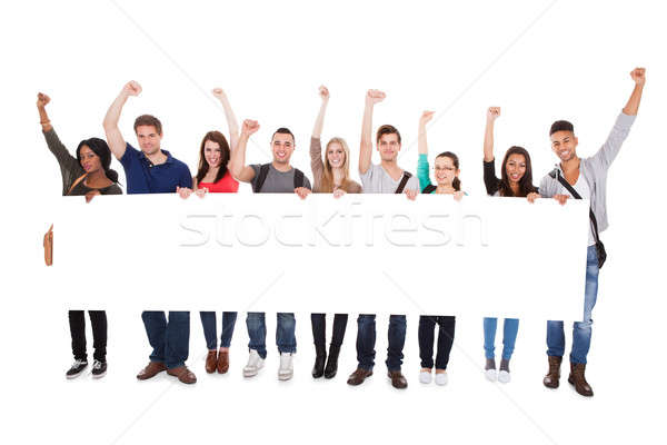 Successful College Students Displaying Blank Billboard Stock photo © AndreyPopov