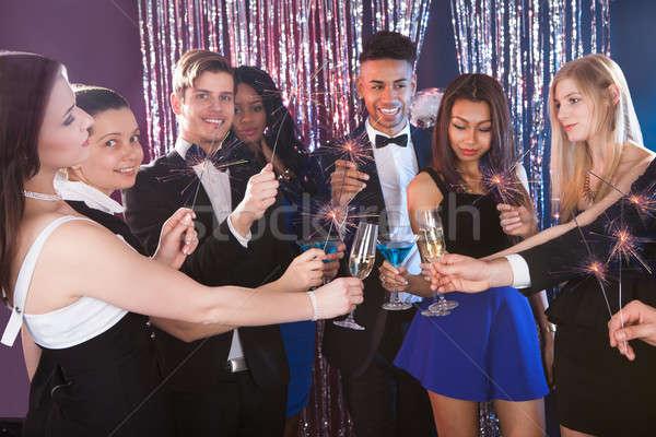 Happy Friends Toasting Drinks At Nightclub Stock photo © AndreyPopov
