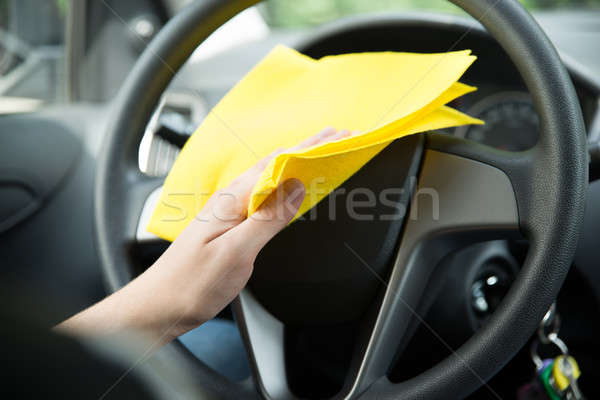 Man Cleaning Steering Wheel Of Car With Cloth Stock photo © AndreyPopov