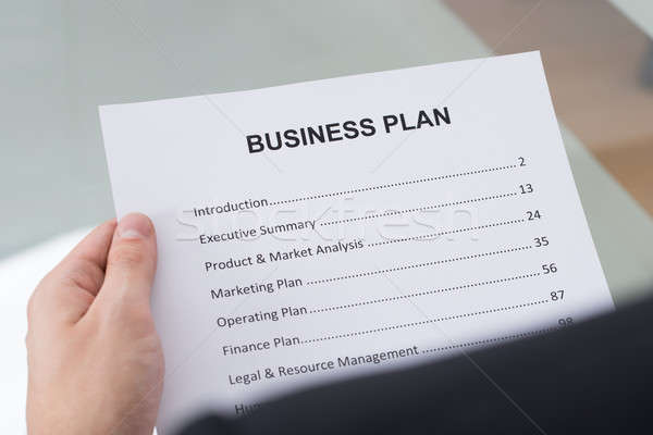 Businessman Reading Business Plan Stock photo © AndreyPopov