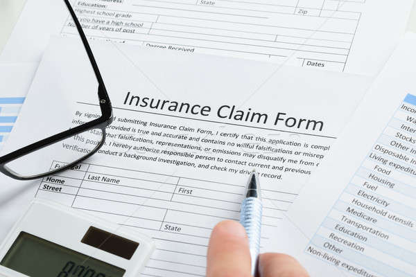 Hand With Pen On Insurance Claim Form Stock photo © AndreyPopov