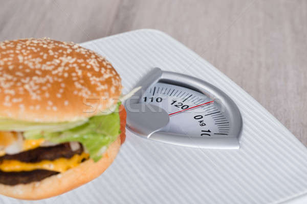 Burger On Weighing Scale Stock photo © AndreyPopov