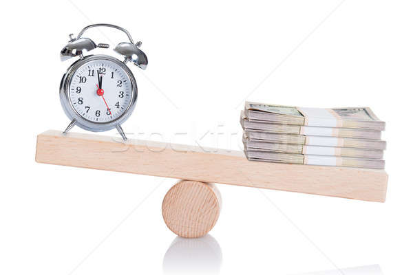 Alarmclock And Stacked Dollar Bundles Balancing On Seesaw Stock photo © AndreyPopov