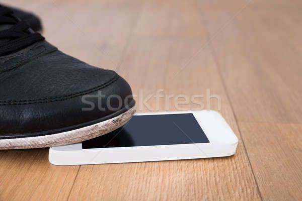 Foot On Cellphone Stock photo © AndreyPopov