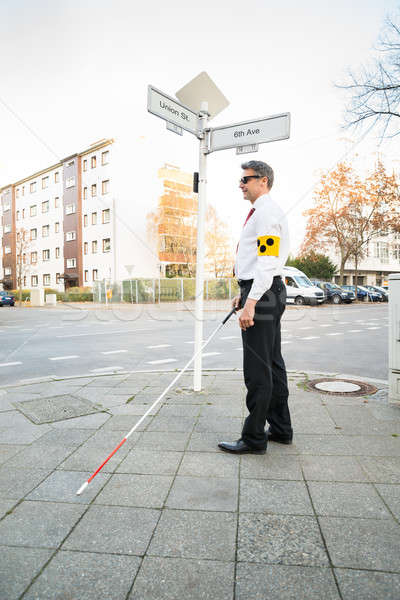 Blind Man Wearing Armband Crossing Road Stock photo © AndreyPopov