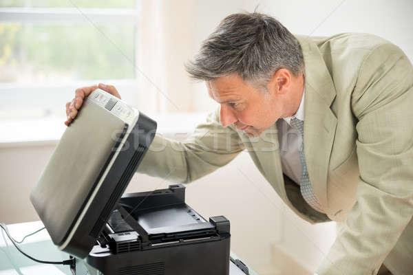 Businessman Looking At Photocopy Machine Stock photo © AndreyPopov