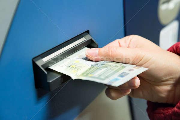 Woman Inserting Cash Into Machine Stock photo © AndreyPopov