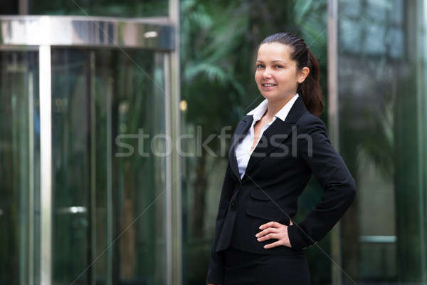 Confident Businesswoman Standing With Hand On Hip Stock photo © AndreyPopov