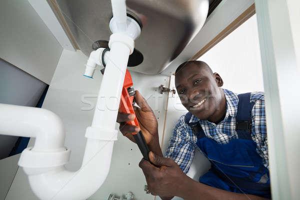 Handyman Repairing Sink Pipe Stock photo © AndreyPopov