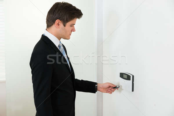 Businessman Operating Security System Stock photo © AndreyPopov