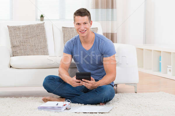 Man Calculating Budget With Calculator Stock photo © AndreyPopov