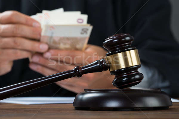 Judge Counting Money At Table Stock photo © AndreyPopov