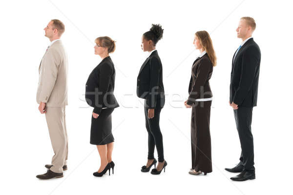Side View Of Business Team Standing In Row Stock photo © AndreyPopov