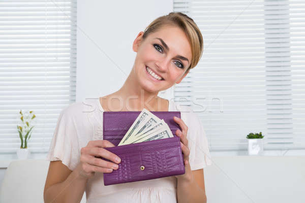 Happy Woman Showing Money In Purse Stock photo © AndreyPopov