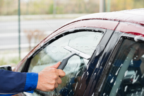 Serviceman Cleaning Car Window At Service Station Stock photo © AndreyPopov