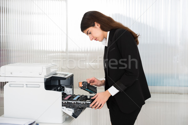 Businessman Fixing Cartridge In Printer Machine At Office Stock photo © AndreyPopov