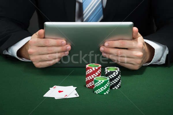 Poker Hand Holding Digital Tablet Stock photo © AndreyPopov