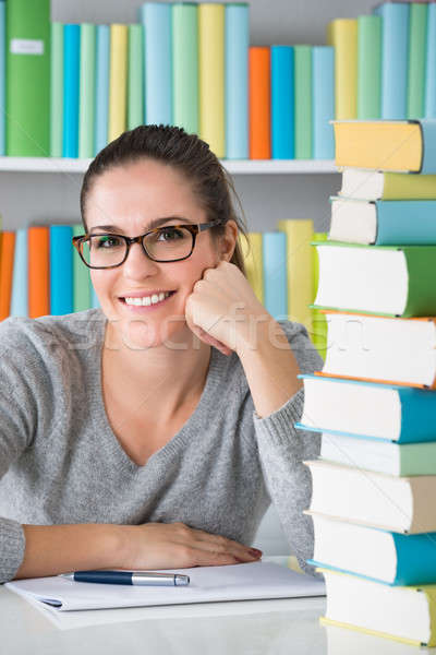 Stock photo: Happy Female Using Laptop In Library
