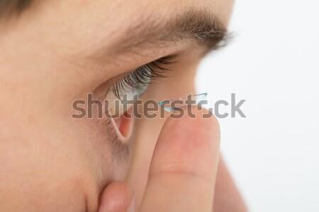 Homem lente de contato olho moço casa Foto stock © AndreyPopov