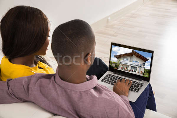 Couple Looking At House Stock photo © AndreyPopov