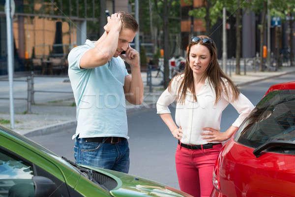 Homem telefone móvel carro colisão triste moço Foto stock © AndreyPopov