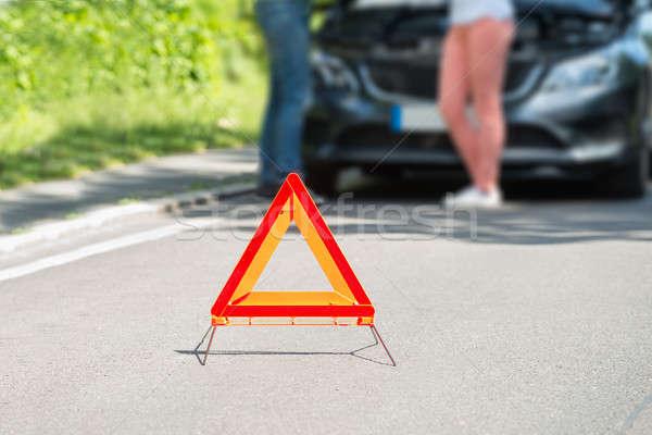 Közelkép figyelmeztető jel pár áll törött lefelé Stock fotó © AndreyPopov