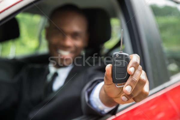 ビジネスマン 座って 車 車のキー 幸せ ストックフォト © AndreyPopov
