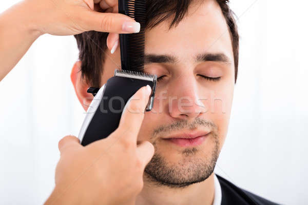 Close-up Of A Hairdresser Cutting Man's Hair Stock photo © AndreyPopov