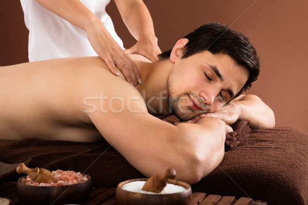 Man schouder massage jonge man arts spa Stockfoto © AndreyPopov