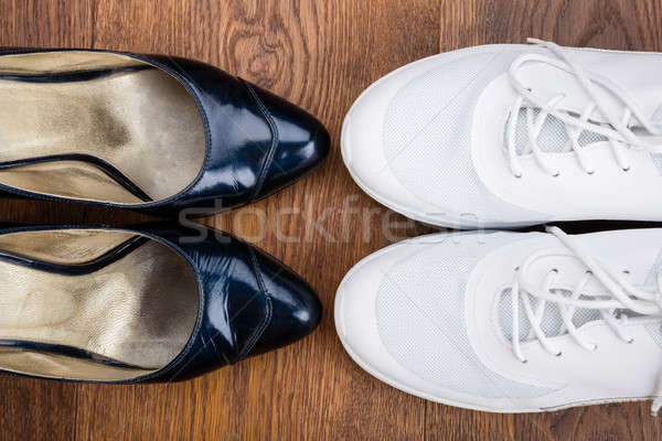 Pair Of Black Sandal And White Shoes Stock photo © AndreyPopov
