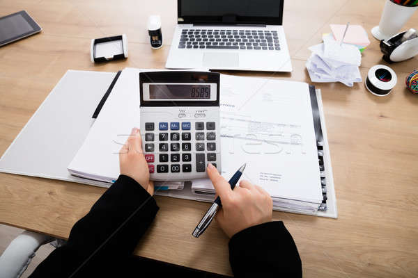 деловая женщина бухгалтер калькулятор Сток-фото © AndreyPopov