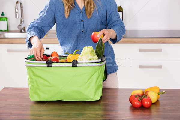 Woman Removing Vegetable From Grocery Bag Stock photo © AndreyPopov