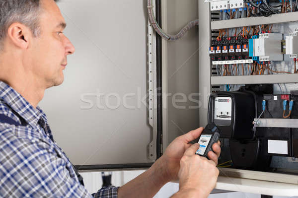 Male Technician Doing Meter Reading Stock photo © AndreyPopov