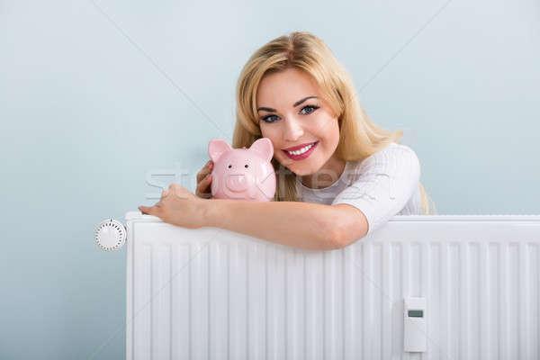Boldog nő persely radiátor fiatal otthon Stock fotó © AndreyPopov